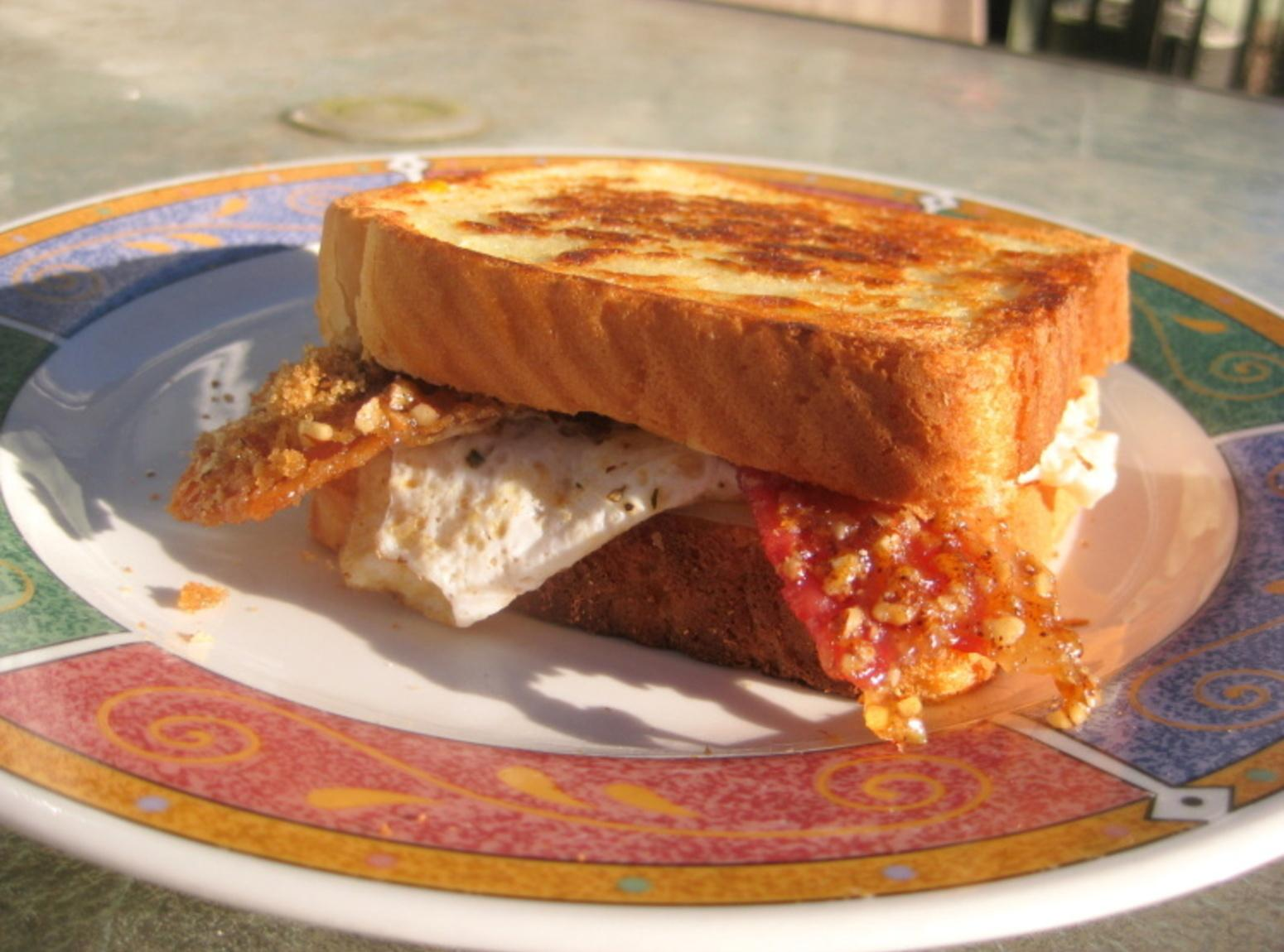 Praline Bacon, Egg and Swiss Cheese Sandwich Recipe | Just A Pinch ...