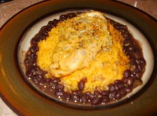 Aprie's Cuban Black Bean, Sauteed Chicken Breast over a Bed of Yellow Rice. Recipe