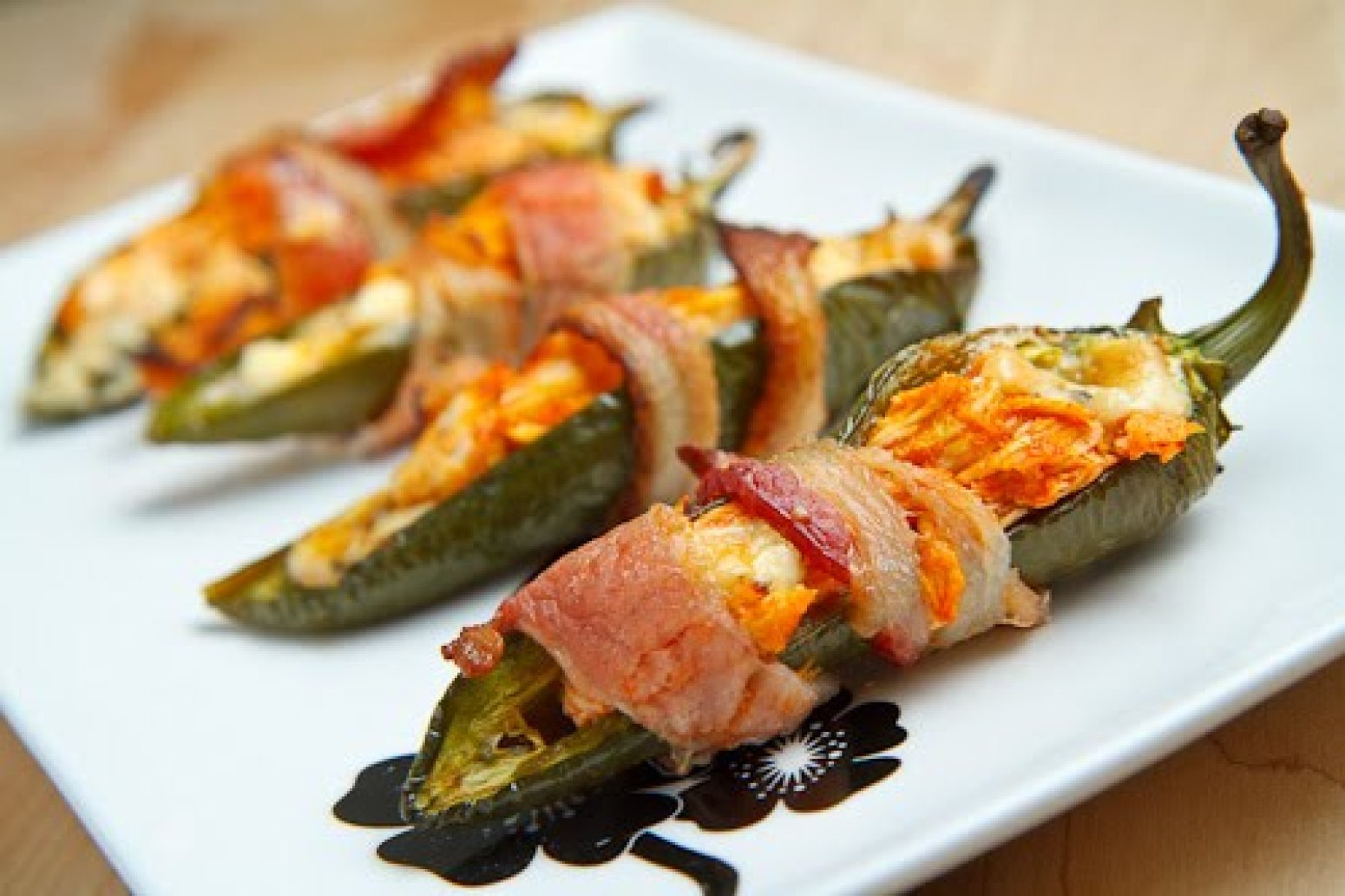Bacon Wrapped Buffalo Chicken Jalapeno Poppers Recipe | Just A Pinch ...