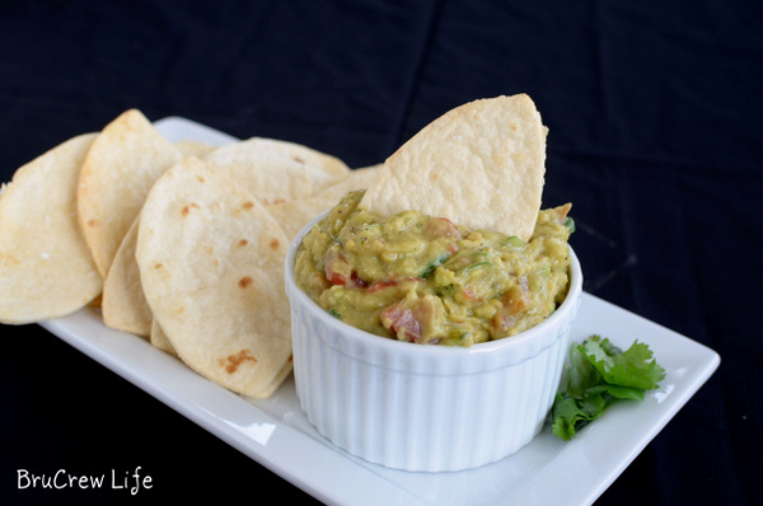 Guacamole Hummus with Football Chips Recipe | Just A Pinch Recipes