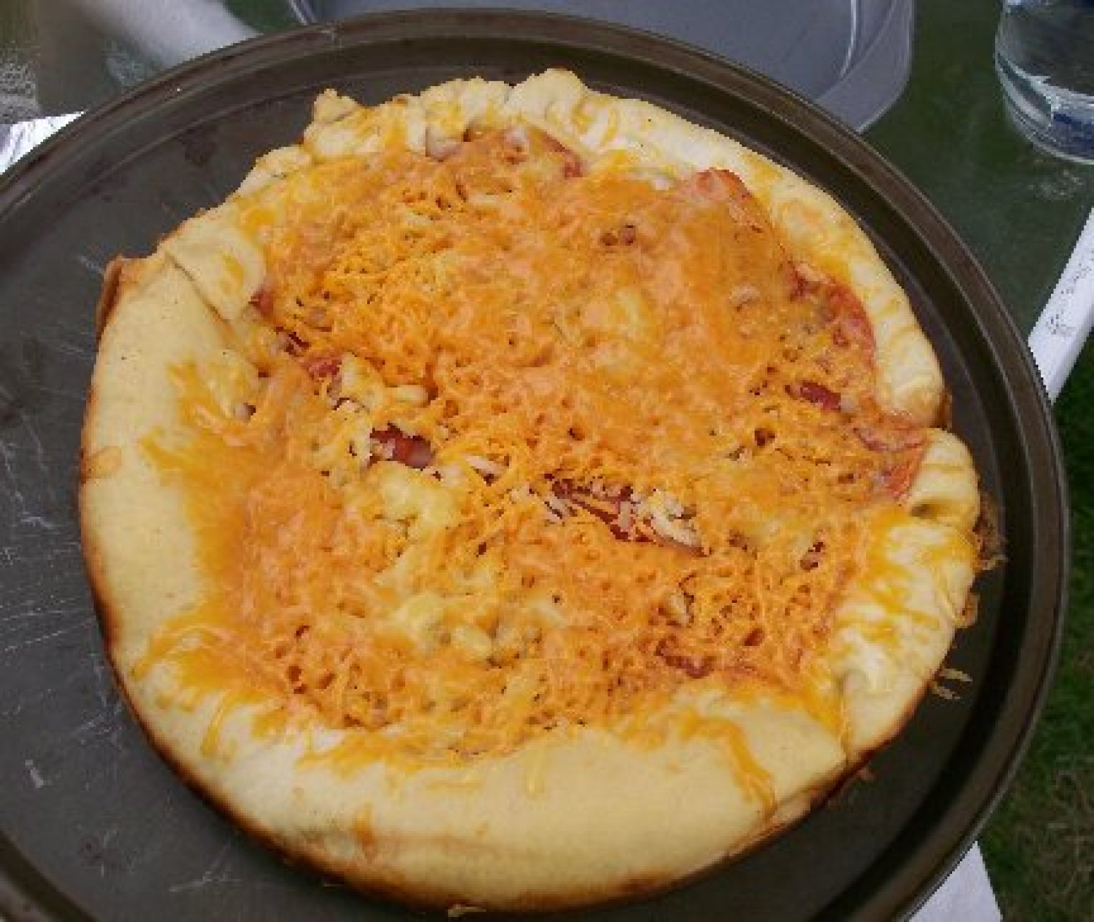 Dutch oven pizza recipe just a pinch recipes for Healthy dutch oven camping recipes