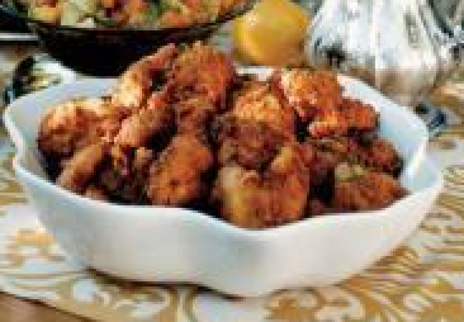 Combine 4 quarts water and salt in a Dutch oven, stirring until the salt dissolves. Remove and discard giblets and neck from chicken. Rinse chicken with cold water; pat dry. Trim excess fat. Add chicken to salt mixture; cover and refrigerate 8 hours or overnight.