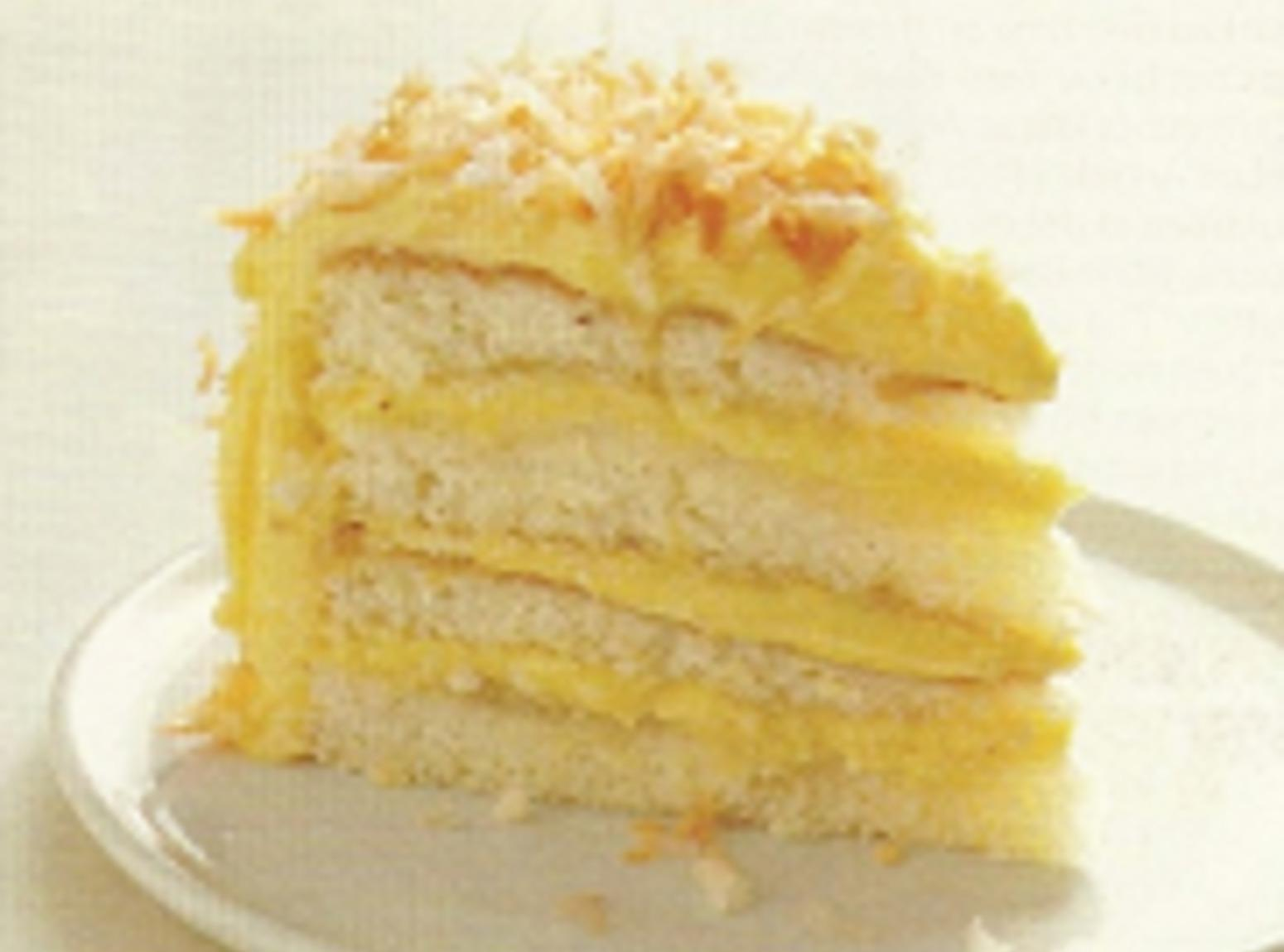 Coconut Cake with Coconut Filling & Buttercream Recipe | Just A Pinch ...