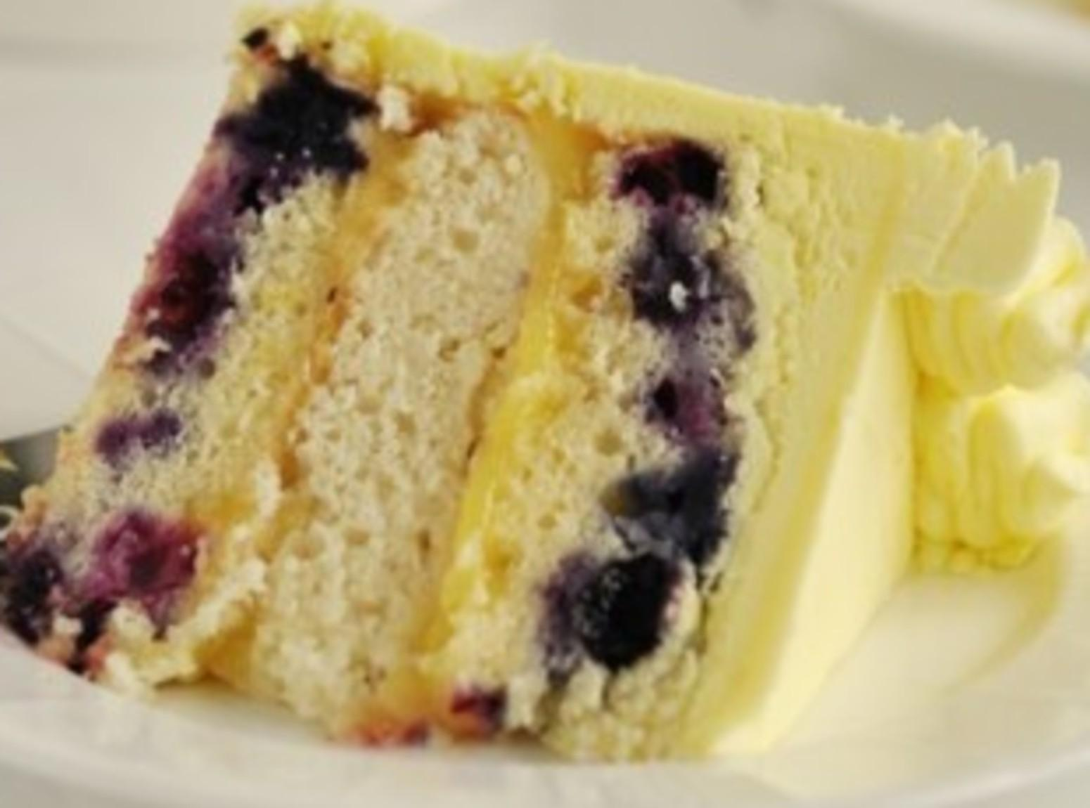 Triple Lemon Blueberry Layer Cake Recipe | Just A Pinch Recipes